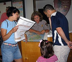 A Teacher Ranger assisting visitors in the Acadia National Park Visitor Center
