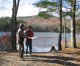 Two site planners visit the South Pond to obtain a lay of the land.