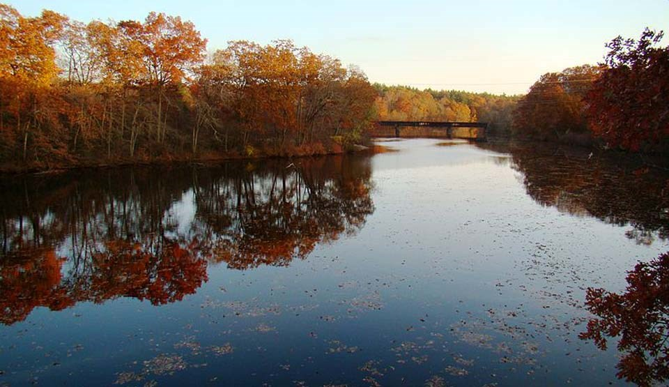 Quinebaug River reflecting autumn leaves on the water