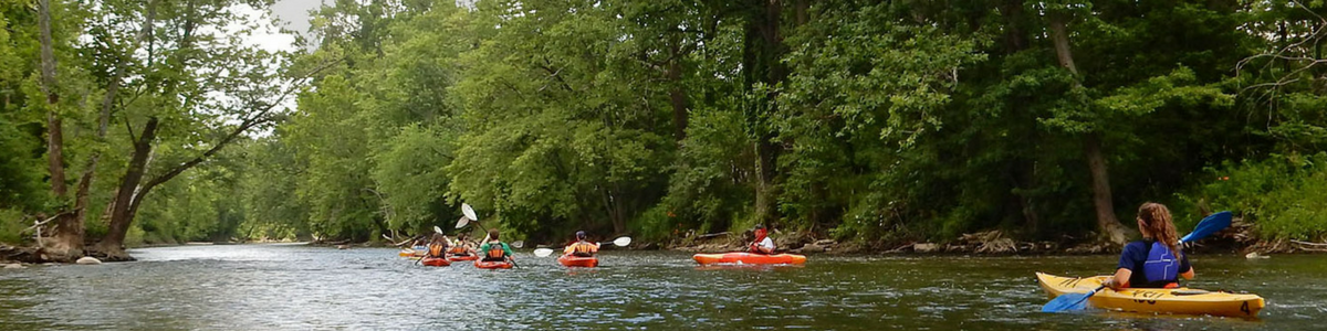 People kayak the Cuyahoga River.