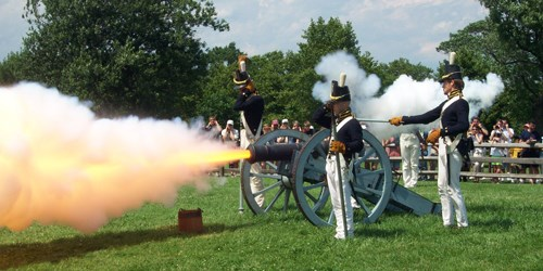 Soldiers firing a cannon