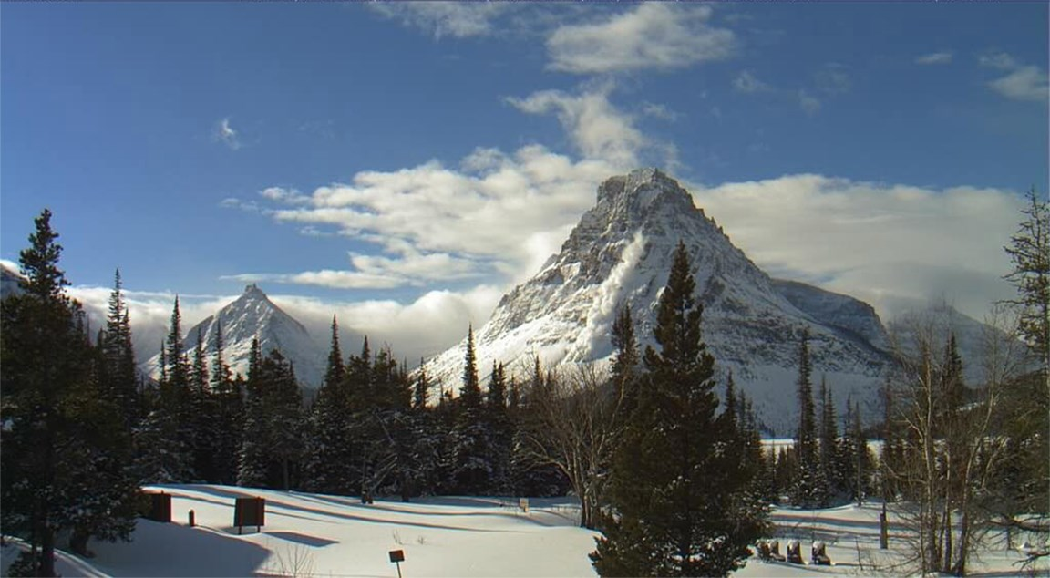 Snowy mountain peak shows avalanche in process at Grand Teton National Park, Wyoming.