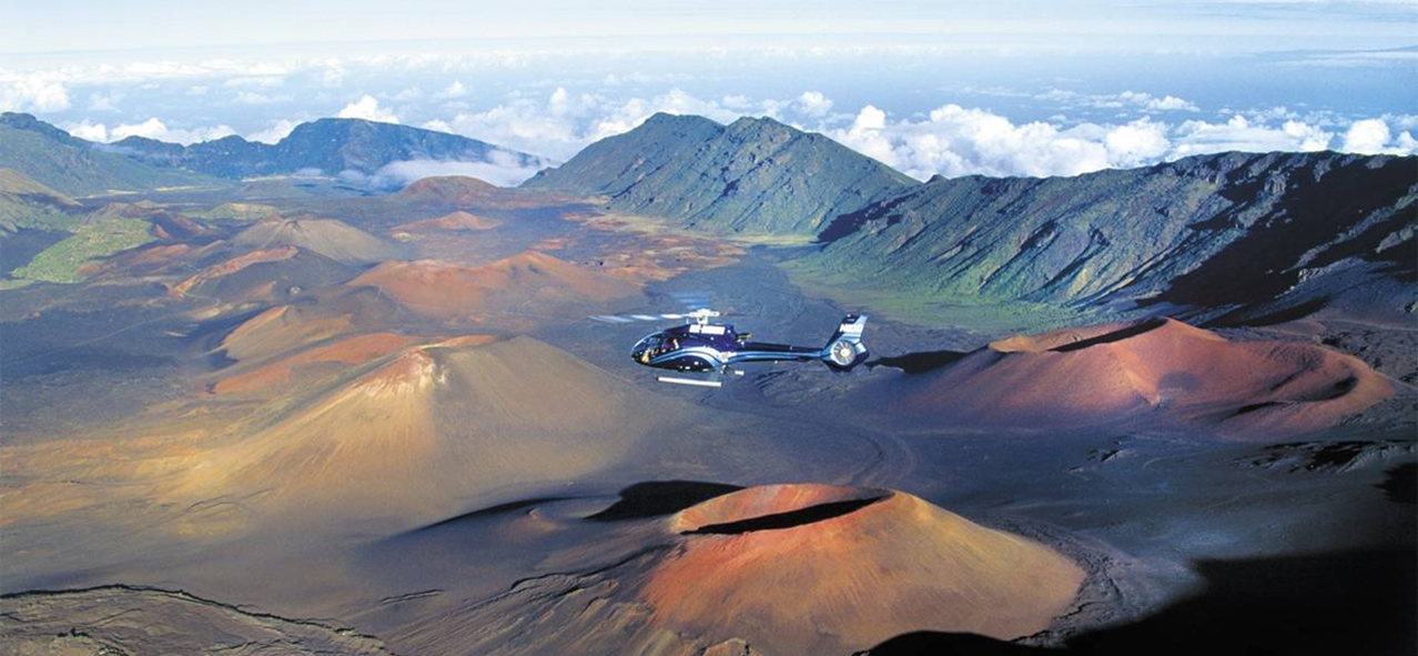 Side view of a helicopter in flight over the Haleakala volcano at Haleakala National Park, Hawaii.