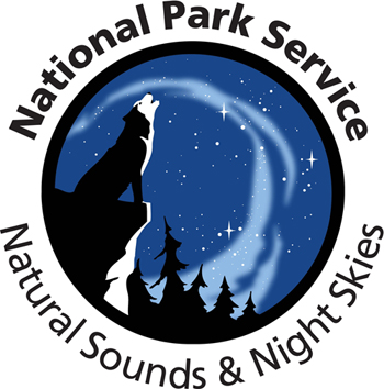 Natural Sounds and Night Skies Division logo features an illustration of a howling wolf under a starry night sky