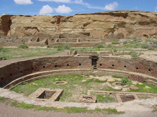 The construction and use of kivas, like Chetro Ketl kiva in Chaco Culture NM, is one of the cultural characteristics of Ancestral Puebloan communities