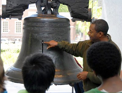 A National Park Service ranger shows visiting children the Liberty Bell. Students on field trips visit the park in large numbers, especially in the spring and fall.