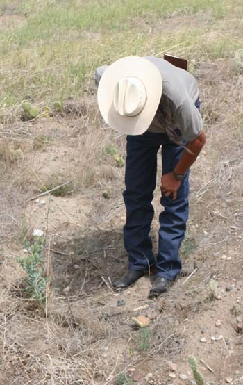 A tribal member identifies plants at Fort Laramie National Historic Site.