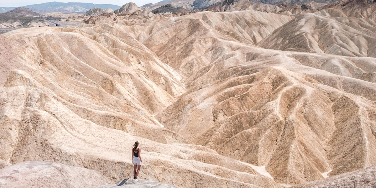 A woman hikes through the hills of Death Valley