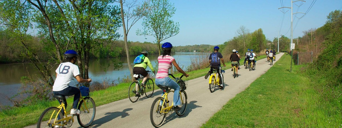 a group ride on bikes next to river