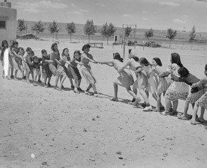 Girls at Isleta Day School in a tug of war, Albuquerque, New Mexico, 1940.