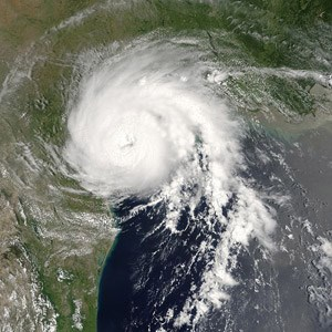 Hurricane making landfall over Texas. Mission Nuestra Señora de la Luz along the Trinity River was flooded by hurricanes.