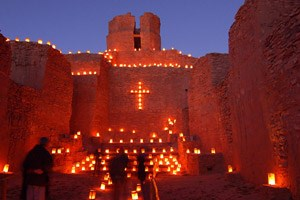 View of the steps of the church entrance and altar steps, decorated with farolitos, or little lanterns, are a Christmas tradition in Northern New Mexico. Although the pueblo and church are no longer occupied, these places are still visited, remembered, an