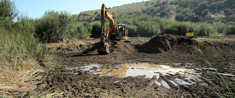 Excavating fill material to restore a buried coastal wetland at Prisoners Harbor, Channel Islands National Park, California
