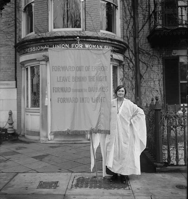 Woman holding sign in favor of Women's Suffrage, circa 1910-1920. Courtesy Library of Congress.
