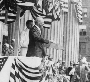 Woodrow Wilson speaks from a box draped with bunting
