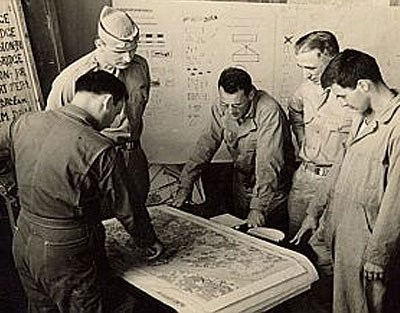 OSS intelligence reviewed existing maps with the military.