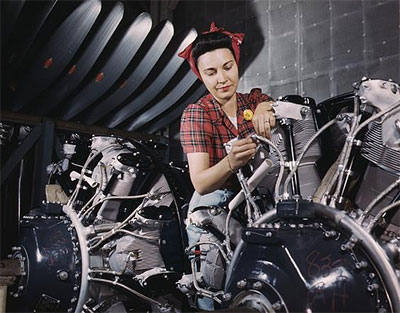 Woman working on an airplane motor at North American Aviation, Inc., plant in Calif.