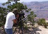 person photographing grand canyon