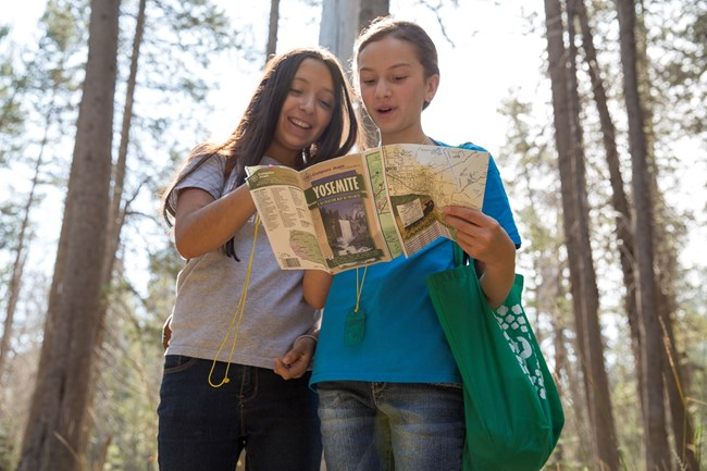 Girl Scout Rangers read map of Yosemite National Park.