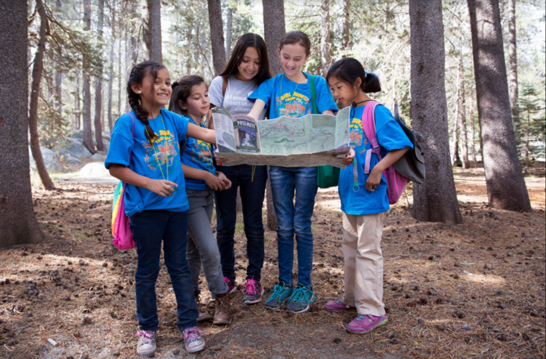 Girl Scouts reading map.
