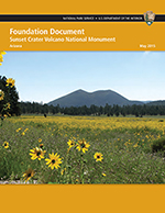 Sunset Crater Volcano Foundation Document cover featuring the cinder cone with wildflowers. Click to open.