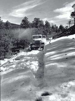 1930s truck on snow-covered mountain road