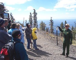 Ranger presenting interpretive talk on mountaintop