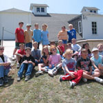 Kids pose for a photo during a field trip to the preserve