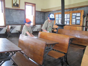 Scouts cleaning the school desks