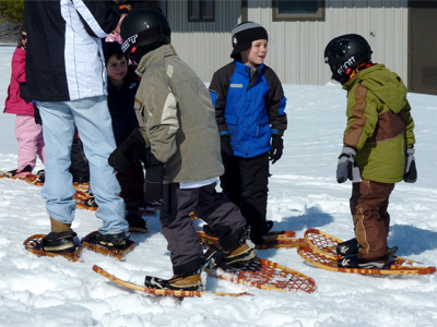 Boys wait for snowshoe hike to begin