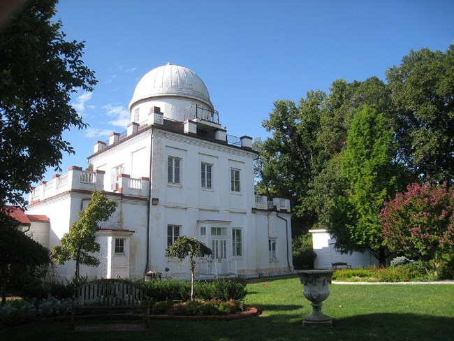 Modern photograph of the Georgetown University Astronomical Observatory, a white square building with a large white dome.