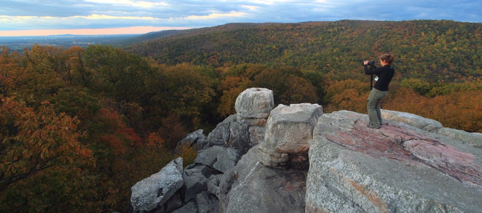 Photographer capturing fall foliage at Chimney Rock.