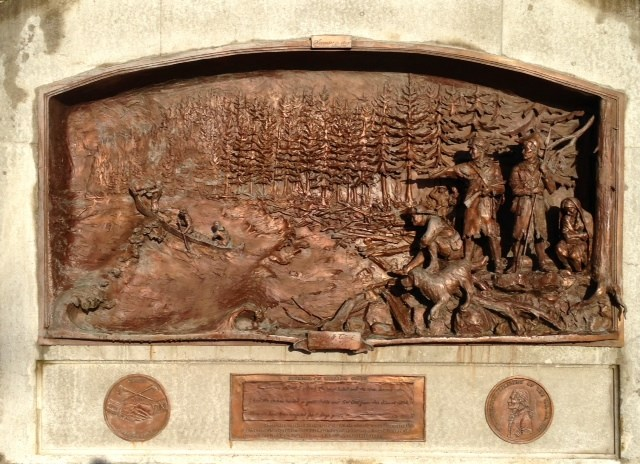 Bronze mural depicting the expedition's arrival at Dismal Nitch