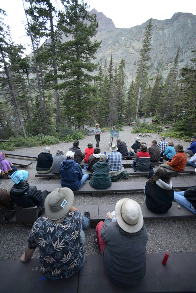 Ranger speaks to group at campground amphitheater