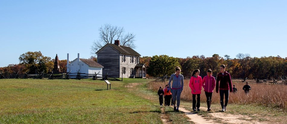 Girls walking on the trail at Manassas National Battlefield.