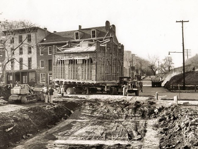 John Brown's Fort atop a truck, being transported to current location in Lower Town