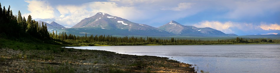 Scenic image of the Kobuk River and mountains in the distance.
