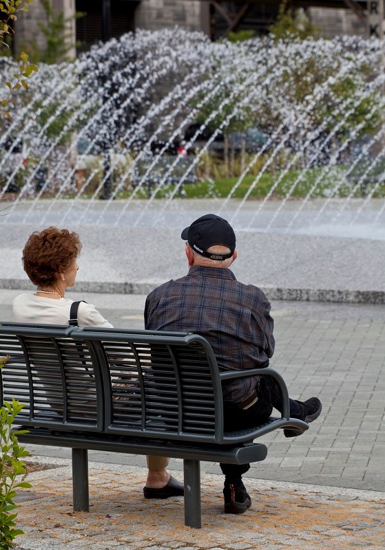 Two visitors sit by the fountains at Georgetown Waterfront Park.