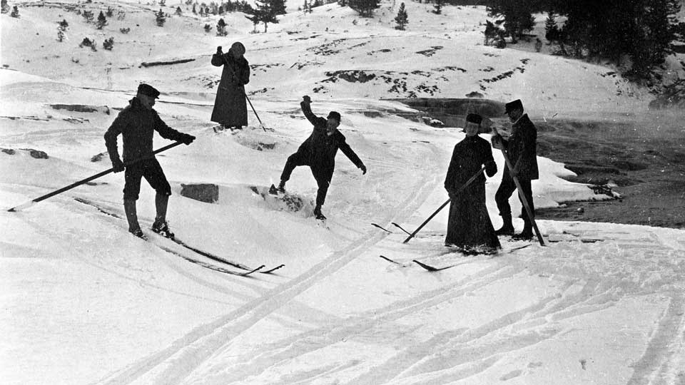 People trying to ski circa 1910
