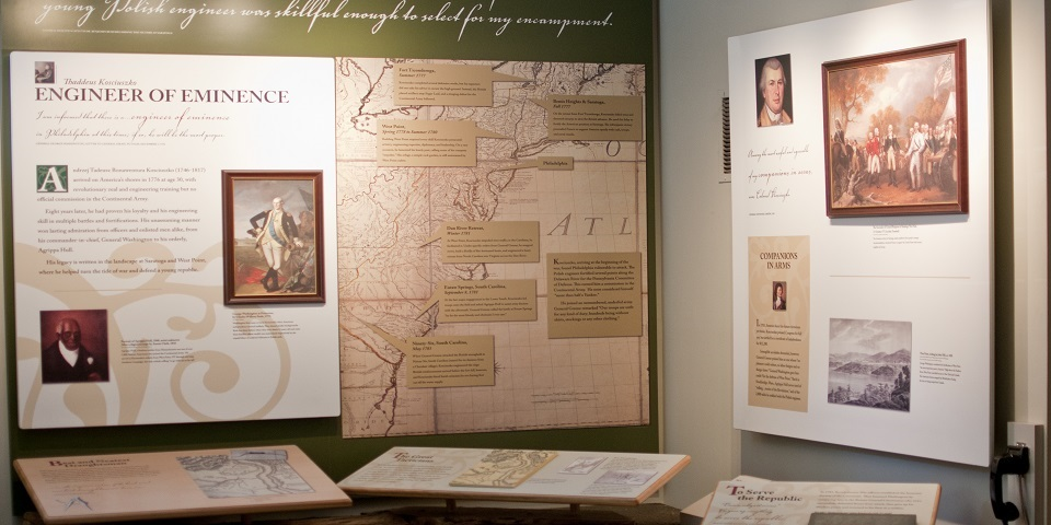 Color photo of large exhibits detailing Kosciuszko's engineering feats using large 18th-century map of the mid-Atlantic colonies.