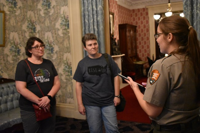 Ranger guides visitors in residence