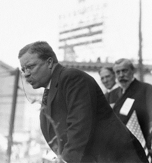 Theodore Roosevelt speaking to a crowd.