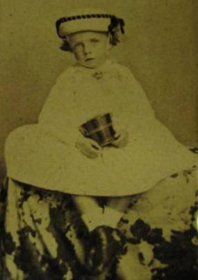 Young Theodore in his christening gown.