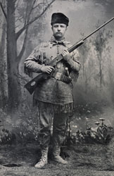 Theodore Roosevelt. TR poses in his hunting attire