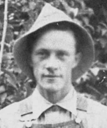 Black and white portrait of George Heber Hansen wearing a hat and overalls.