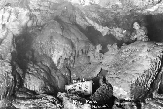 Early black and white photo of Hansen Cave showing large flowstone formation.
