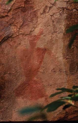 Fremont pictograph; series of rust red triangles resembling a person on sand colored rock.