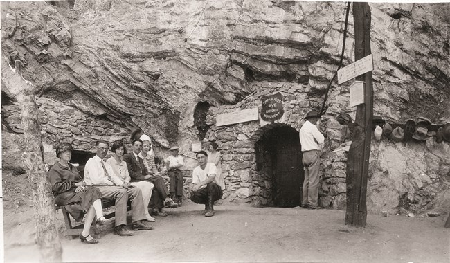 Historic photograph of people waiting for a tour outside Timpanogos Cave.