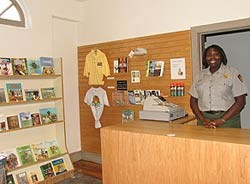 Ranger at visitor center and bookstore desk
