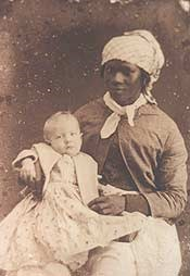 Historic photograph of an unnamed slave woman holding a white child